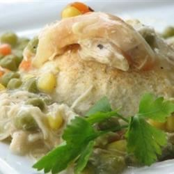 Chicken and Biscuit Casserole Recipe and Video - Packed with assorted veggies, this giant chicken pot pie wears a delicate buttermilk biscuit topping.