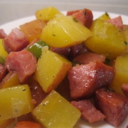 Polish Meat and Potatoes Recipe - Kielbasa is cooked on the stovetop with potatoes and onion. This is an old recipe from my grandmother. 'Good Polish-Slovak food!'  She would always say.  'Eat more!'
