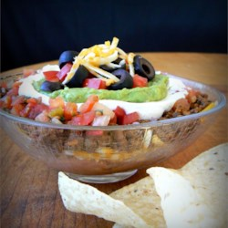Seven Layer Dip I Recipe and Video - This is a great party dip because it's best served at room temperature. You can set it out on the table early and finish cooking the rest of your meal.