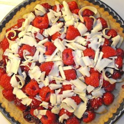 Raspberry Tart Recipe - Fresh summer raspberries in raspberry jam on a buttery crust.