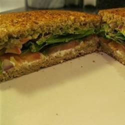 Super BLT Recipe - Guacamole and cream cheese add a unique twist to the traditional bacon, lettuce, and tomato sandwich.