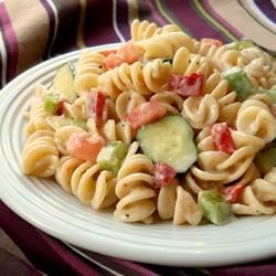 Italian Pasta Salad I Recipe - This fun salad has two dressings  - Italian and creamy Caesar. And with the exception of some diced bell pepper and onion, it 's all pasta.