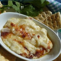 Vidalia Sweet Onion Dip Recipe - Thinly-sliced Vidalia sweet onion is baked in a mixture of mayonnaise, Swiss cheese, and Parmesan cheese for this creamy dip.