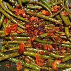 Daphne's Green Beans Recipe - Fresh green beans, onion, and canned tomatoes are spiced up with chipotle peppers in adobo sauce for this terrific vegetable side dish.