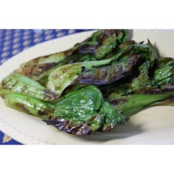 Grilled Bok Choy Recipe - Bok choy is brushed with seasoned butter as it grills, for grill marks on the tender stems and crispy leaf edges. It's a different and tasty vegetable side for your grilled main dish.