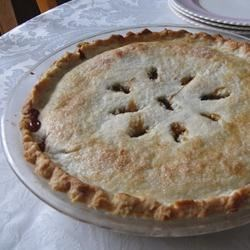 Old Fashioned Raisin Pie I Recipe - Raisins are plumped in water, and brown sugar, cornstarch, cinnamon, vinegar and butter are stirred in. The filling is poured into a pastry shell, covered with a top crust, and baked in a hot oven for 30 minutes. Cool and serve with ice cream.