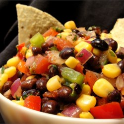 Heather's Cilantro, Black Bean, and Corn Salsa Recipe - This lively summer recipe can be served with tortilla chips as an appetizer, or with chicken or fish as a fresh and flavorful side dish. Made with corn, black beans, tomato, onion, pepper, and avocado, this salsa has the most amazing balance of textures in a great presentation.