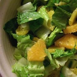 Orange Romaine Salad Recipe - Romaine lettuce and orange slices are tossed with a light honey vinaigrette.