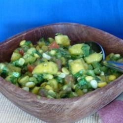 Mango Corn Salsa Recipe - Tropical mango and hot serrano peppers flavor a salsa that is chunky in a smooth, saucy base.