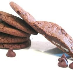 Chocolate Cookies Recipe - My grandmother used to make these and what a favorite they are.  As I type this recipe, I see her handwriting and remember those good ole days! These are a delicate, cake like cookie with chocolate frosting.  The nuts are optional, if you like them add them. Pecans or peanuts taste just as great as walnuts do.