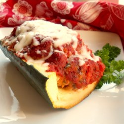 Italian Meatloaf in Zucchini Boats Recipe - Meatloaf with Italian flavors is baked inside hollowed-out zucchini boats, and topped with spaghetti sauce and melted mozzarella cheese.