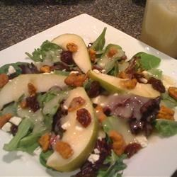 Fresh Pear and Cherry Salad with Vanilla Pear Vinaigrette Recipe - A mix of juicy pears, sweetened nuts, dried cherries, and feta cheese makes this is a show-stopping sweet salad!
