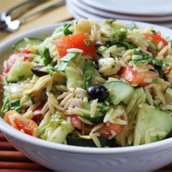 Greek Orzo Salad Recipe - Orzo pasta is tossed with artichoke hearts, cucumber, feta, tomato, olives and a zesty dressing.