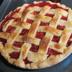 My Own Strawberry Rhubarb Pie Recipe - A strawberry-rhubarb pie, heaped with filling, has a pretty lattice top. The filling has delicious flavors of brown sugar, allspice, and a touch of cinnamon. Filling will thicken as the pie stands.