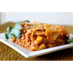 Beef Nacho Casserole Recipe - A simple meal to whip up in less than an hour that even the kids are sure to love. Layers of seasoned ground beef, corn, tortilla chips and cheese are baked under a layer of Colby cheese. Monterey Jack is also good in place of the Colby cheese.