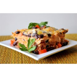 Black Bean Lasagna Recipe - A delicious vegetarian lasagna using corn tortillas instead of lasagna noodles, layered with salsa, black beans, cheese, and guacamole.