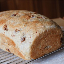 Date and Nut Bread Recipe - Chopped dates and almonds lend extra sweetness and fiber to this oat-wheat bread from the bread machine.
