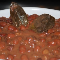 Pammy's Slow Cooker Beans Recipe - Smoked turkey leg meat amps up the flavor of a simple slow-cooked bean dish. Serve these yummy, smoky beans on hot cooked rice or with cornbread.