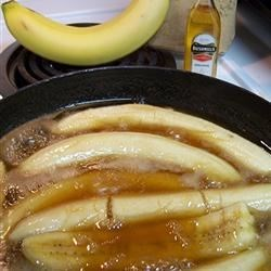 Irish Bananas Recipe - Bananas are simmered in brown sugar, butter and Irish whiskey for a delicious warm treat to serve with vanilla ice cream.