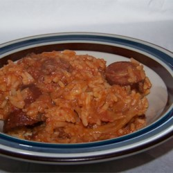 Lazy Golumbkis Recipe - Ground beef, cabbage, onion, rice and tomato sauce are combined in a slow cooker.