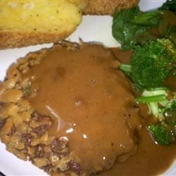 Mock Chicken Fried Steak Recipe - Ground beef is mixed a few spices and formed into patties that are breaded and fried. I'm not sure where my mom got this recipe, but she used to make it at least once a month. Although she never served it with gravy, I think peppered gravy would go great with this.