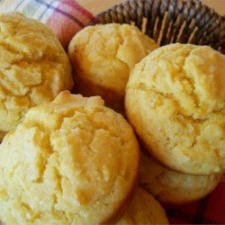 Savory Corn Muffins Recipe - This recipe yields a bread that's moist and savory and tastes distinctly of corn. Unlike many corn muffins, these stay moist, thanks to canned creamed corn.