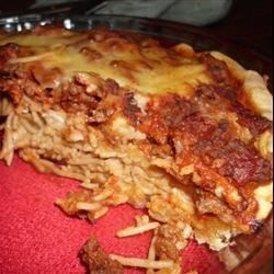 Three Cheese Spaghetti Pie Recipe - Fill a pre-made pie shell with a layer of spaghetti coated with egg white and Parmesan, spread with a creamy mix of egg yolk, ricotta, parsley and mozzarella, spoon in a meaty tomato sauce, then top with mozzarella and bake for a sensational party dish.