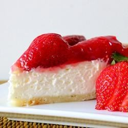 Two Tier Strawberry Pie Recipe - A layer of cream cheese makes a delicious twist under a succulent mound of glistening fresh strawberries.