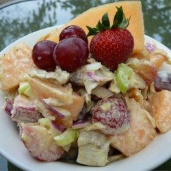 Chicken and Melon Salad Recipe - A creamy yogurt and sour cream dressing is perfect for this salad, especially after a bit of curry powder is swirled in. The water chestnuts add a nice crunchiness to the honeydew melon, grapes and moist chicken. Serves ten.