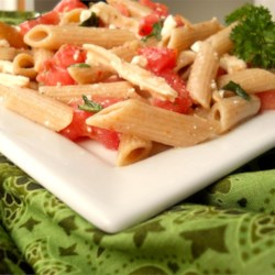 Chicken Pasta Salad I Recipe - Bits of broiled chicken seasoned with lemon pepper and garlic powder are tossed with pasta, roma tomatoes and tangy feta cheese. The Italian dressing of your choice finishes this savory summer salad.