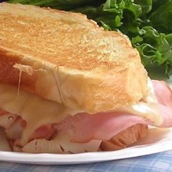 Chicken Cordon Bleu-ish Grilled Sandwich Recipe - A savory skillet-browned sandwich features the flavors of chicken, ham, and Swiss cheese.