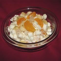 Mama's Ambrosia Recipe - A sweet concoction of mandarin oranges, fruit cocktail, coconut, marshmallows and crunchy walnuts is nestled in smooth sour cream in this favorite dessert salad.