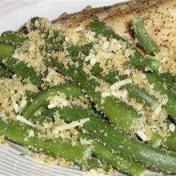 Green Beans with Bread Crumbs Recipe - Cooked green beans are tossed with garlic powder, bread crumbs, olive oil, oregano and basil, and given a fine sprinkling of Parmesan cheese.