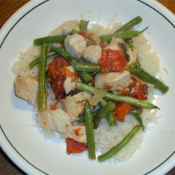 Italian Green Bean Chicken Recipe - This is a really flavorful dish featuring simmered chicken and green beans in a simple tomato sauce.