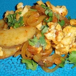 Aloo Gobhi Recipe - Try this version of a classic vegetarian Indian stir-fry dish featuring cauliflower and potatoes.