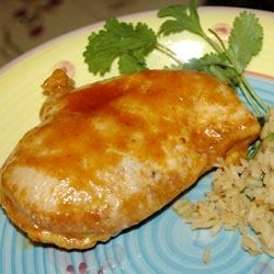 Texas Curried Chicken Recipe - Pieces of chicken are roasted with butter, then glazed with a sweet curry glaze during the last bit of cooking time for tender chicken that is full of Texas flavor.