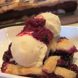 Book Club Blackberry Cobbler Recipe - A beautiful southern-style blackberry cobbler uses canned berries and self-rising flour, so it's easy to have anytime.