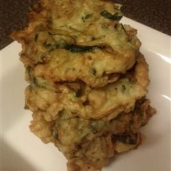 Old-Fashioned Italian Zucchini Fritters Recipe - Parmesan cheese and fresh basil season these delicious fried zucchini fritters.