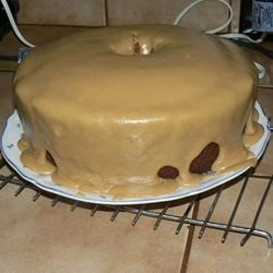 Caramel Pound Cake Recipe - This cake is made with dark brown sugar which gives it a caramel flavor. It has pecans in the batter and is frosted with a delicious caramel frosting.