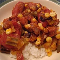 Hearty Creole Okra and Tomatoes Recipe - A great Southern okra dish made with andouille sausage, corn, tomatoes, onions, and celery.