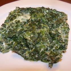 Easy Spinach Souffle Recipe - Spinach baked into a souffle with egg, milk, Parmesan cheese and garlic.  You can also make this dish in the microwave when you're short on time.