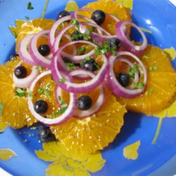 Orange and Onion Salad Recipe - Orange slices, red onion, and black olives are simply dressed in this tangy salad.