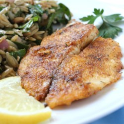 Pan-Seared Tilapia Recipe - This pan-seared tilapia dish is a delicious and easy way to prepare seafood! Great for a quick weeknight meal accompanied with fresh veggies.