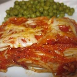 Pasghetti Pizza Recipe - Vermicelli, angel hair or any thin spaghetti type noodle, baked with lots of melted Mozzarella and Parmesan cheese.
