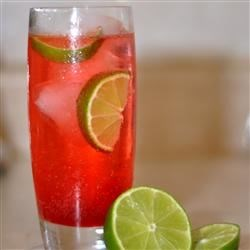 Cherry Limeade II Recipe - A thirst quenching drink with lemon-lime soda and grenadine with a wedge of lime squeezed in for good measure.
