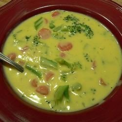 Wisconsin Cheese Soup II Recipe - Carrots, broccoli and onion are cooked in chicken bouillon then combined with milk and sharp Cheddar in this quick soup.