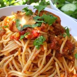 Mariu's Spaghetti with Meat Sauce Recipe - An authentic Italian recipe for a savory spaghetti sauce made with ground beef, onion, celery, fresh mushrooms, dried basil, and dried mint.