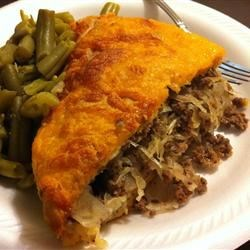 Bierock Casserole Recipe - A savory ground beef and sauerkraut mixture baked between two layers of crescent roll dough, in the style of bierock pastries. This is almost as good as the orginal bierock, but is a lot less time consuming!