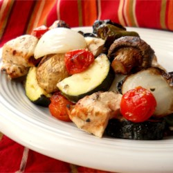Greek Island Chicken Shish Kebabs Recipe - Chicken is marinated in a Greek-style mixture of herbs with oil, vinegar, and lemon juice before being threaded onto skewers with bell pepper, mushrooms, and tomatoes for a tasty spin on grilled chicken.
