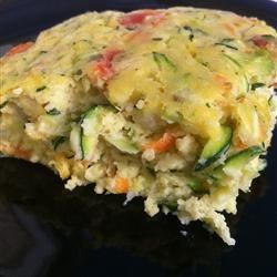 Zucchini Pie Recipe - A little like a quiche, a little like a pie--and the best of both. This easy crustless quiche is made with zucchini, baking mix, and Parmesan cheese.